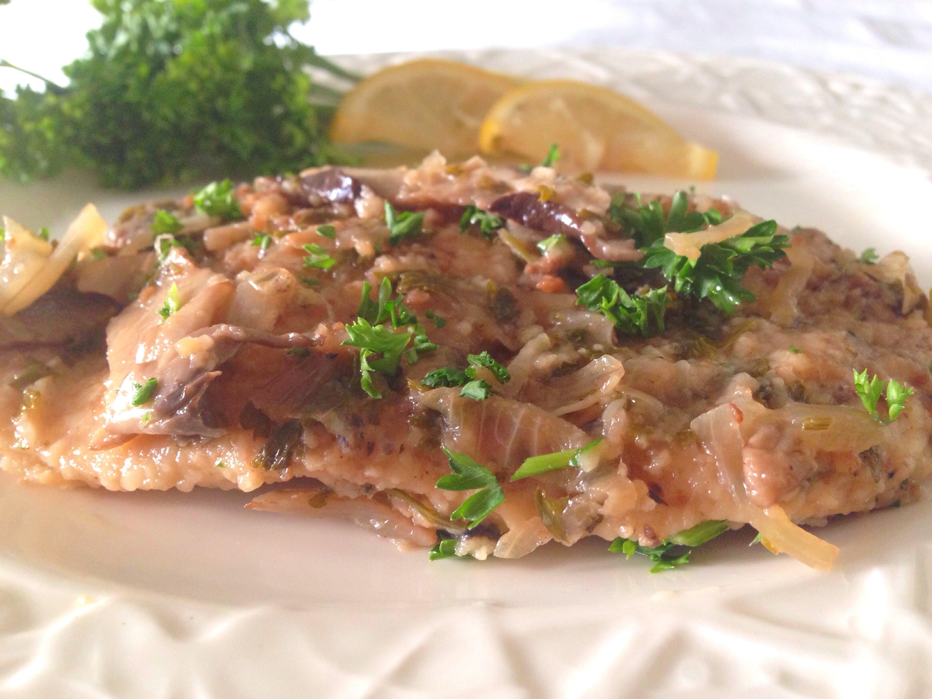 Chicken with mushrooms and lemon plate